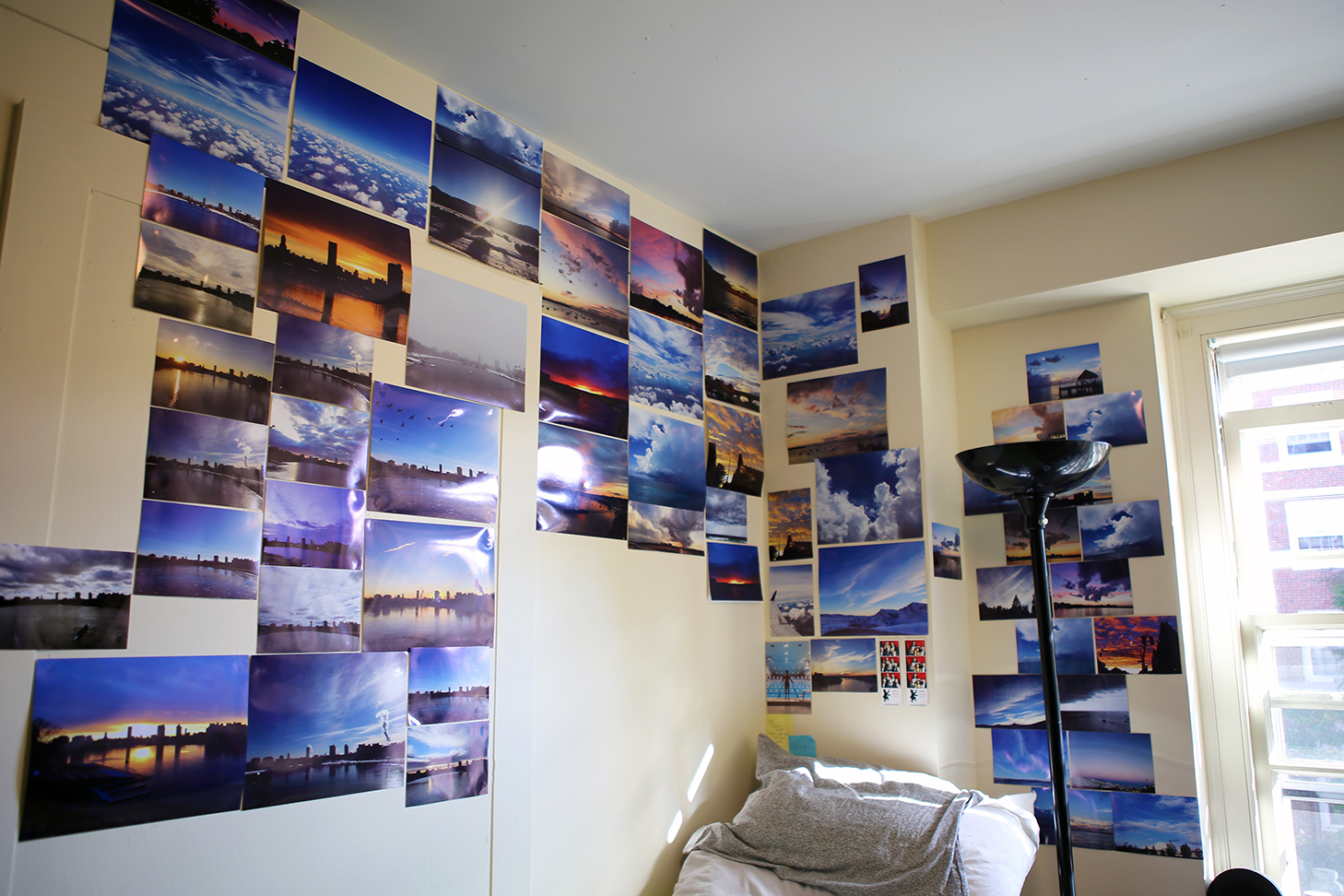 Bailar's wall is full of pictures of colorful skies and sparkling water.
