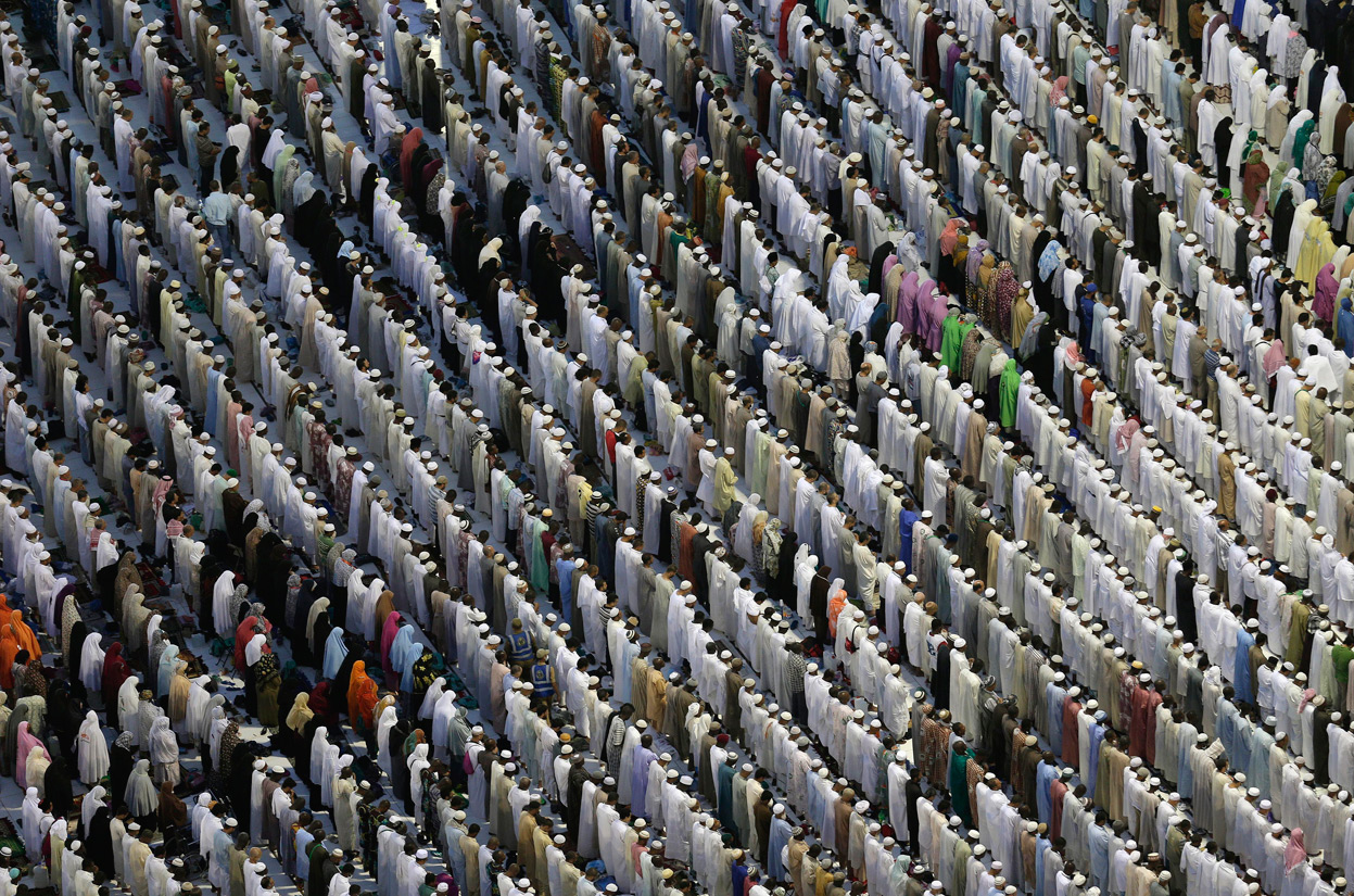 Pilgrims pray outside the pilgrimage during Hajj 2012.  Photo taken by Hassan Ammar for the Associated Press. October 2012
