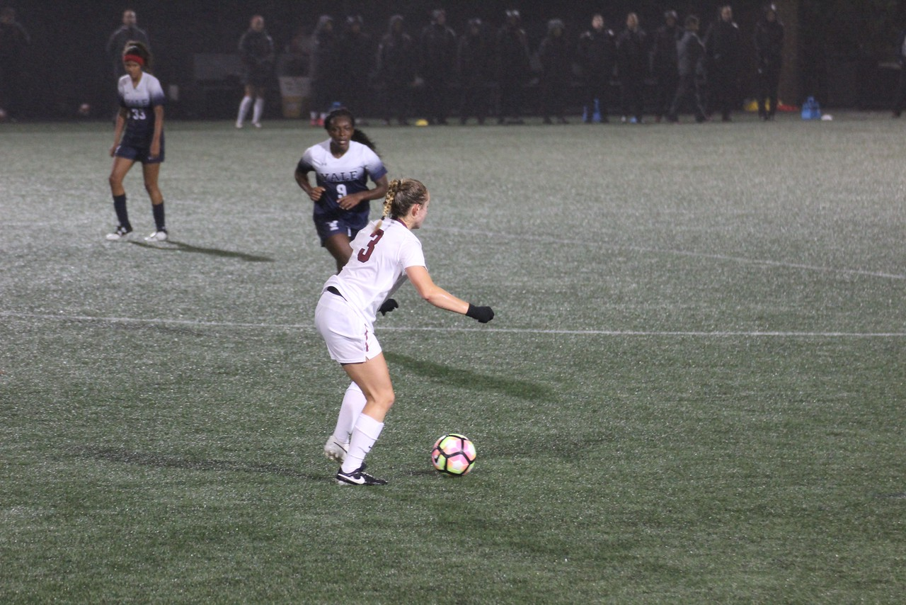 Now-junior forward Alli Wiggins looks to play the ball through mid-field in last October's match versus Yale. The Methuen, Mass., product started 10 games for the Crimson last season, helping her team finish at 10-4-3 before bowing out of the NCAA tournament to No. 22 Rutgers.