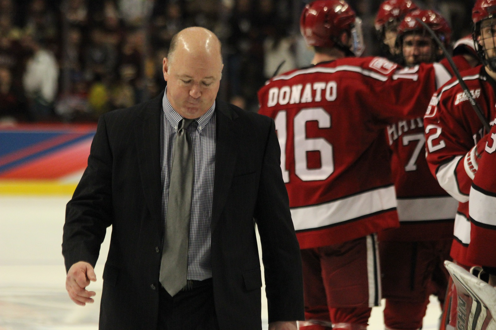 After bowing out of the NCAA Tournament in April's Frozen Four, coach Donato leaves the ice and lets his son Ryan have a moment with the outgoing seniors.