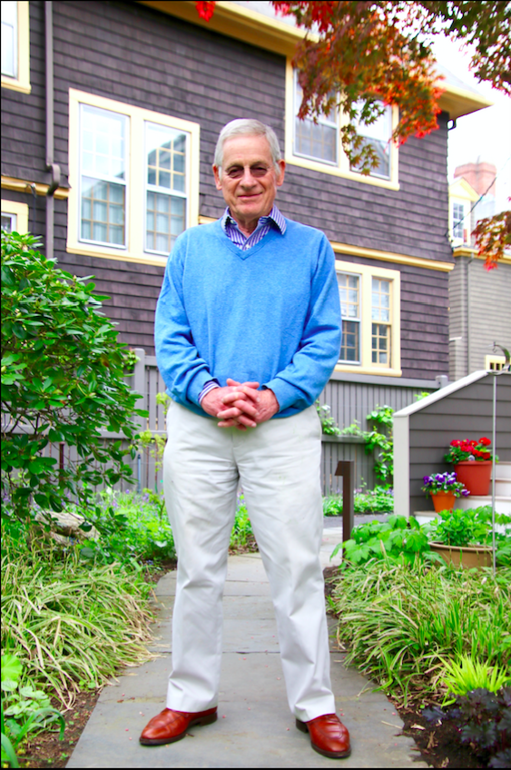 Harvey C. Mansfield Jr. '53, who has worked at Harvard for over 50 years, poses outside of his home.