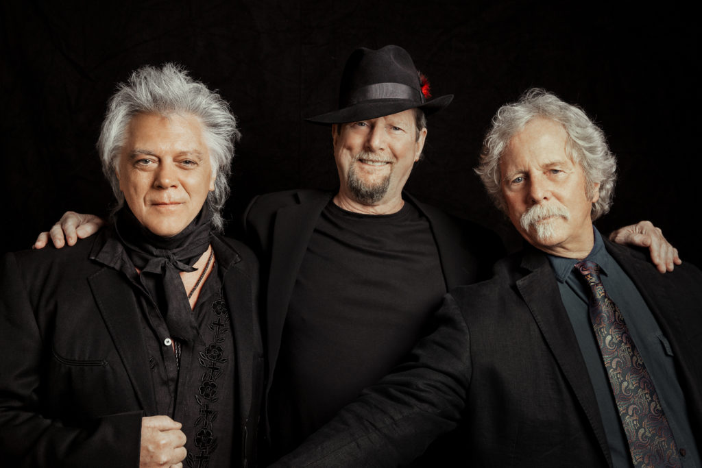 "Marty Stuart, Roger McGuinn, and Chris Hillman pose together for the ""Sweetheart of the Rodeo"" 50th anniversary tour."