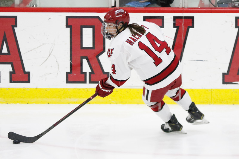 Senior co-captain Kate Hallett controls the puck in what ended up as her final game for the Crimson.