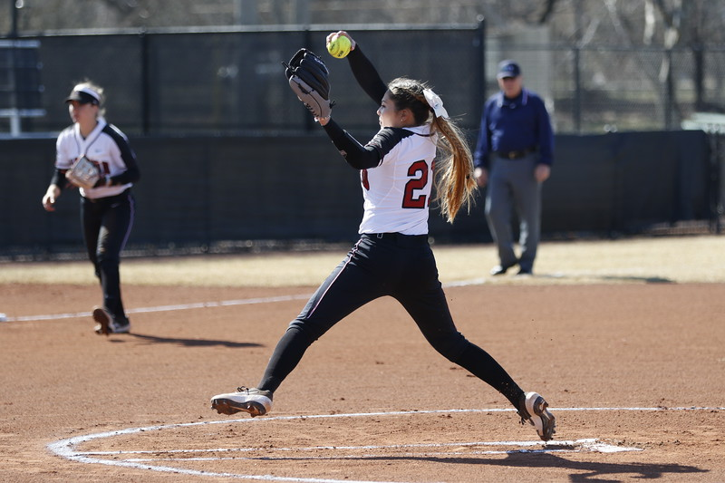 Junior pitcher Alissa Hiener winds up to launch a swift pitch at her opponent.