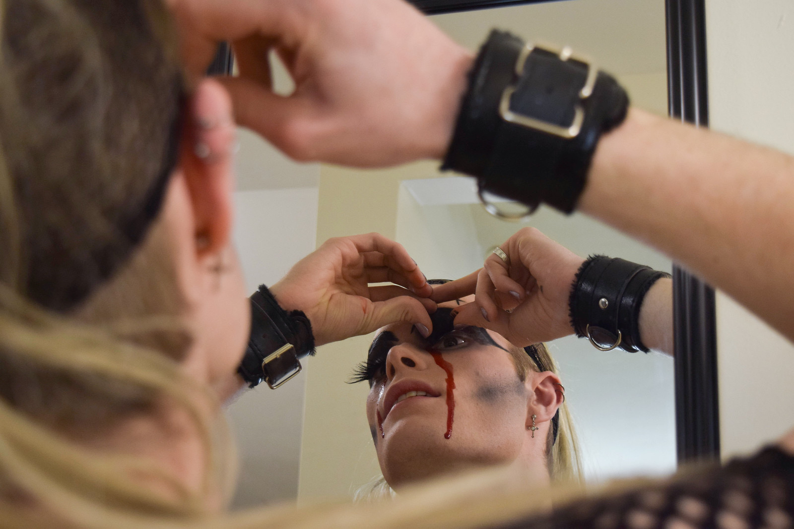 Casey R. Goggin '19 carefully applies fake eyelashes to complete their look.