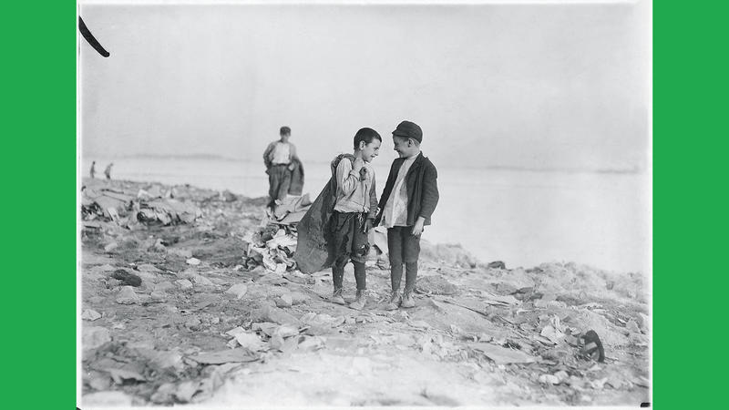 """Lewis Hine's 1909 photo, """"Boys Picking Garbage from 'The Dumps.'"""""""