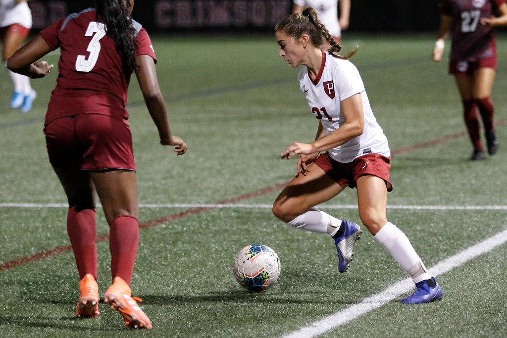 Freshman midfielder/forward Gabby DelPico dribbles across the field during Harvard's matchup against UMass. The Massachusetts native has two goals and one assist so far in six games that she has played in this season (this includes five starts).