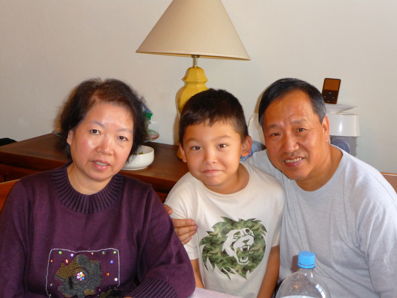 5-year-old Matteo N. Wong '22 sits with his grandparents in his home in Brooklyn.