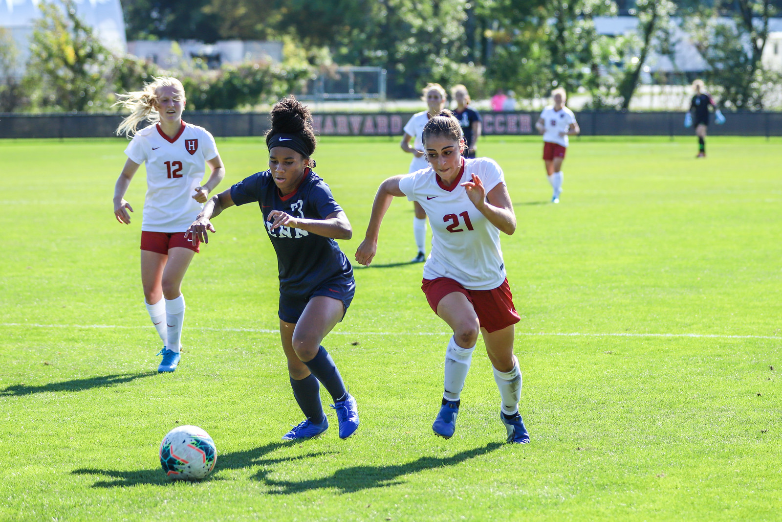 Gabby DelPico maneuvers by a Penn defender on Sunday. The freshman forward scored the sole goal of the match to help Harvard to its fourth-straight win.