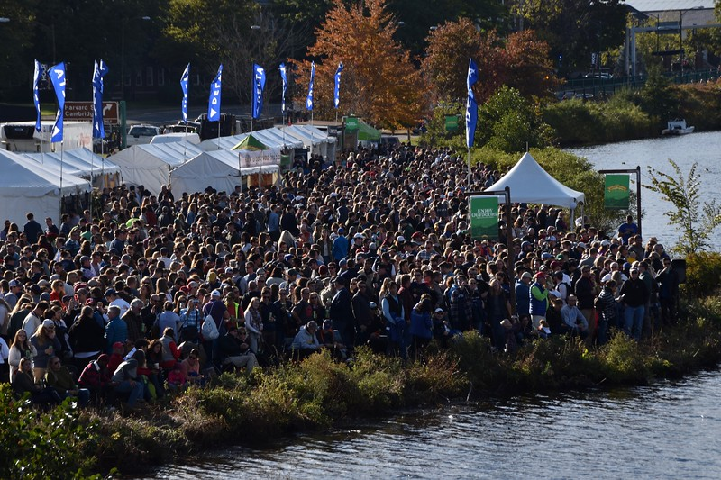 Spectators gather at the festivities on the Boston banks of the Charles to take in the regatta's action.