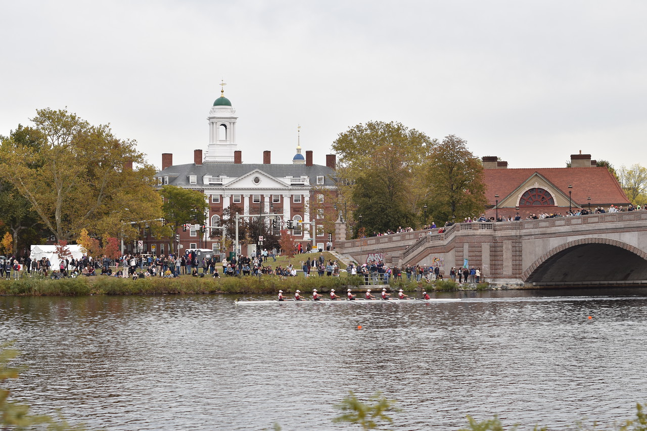 Thousands of spectators line the banks of the Charles River as boats pass by the Anderson Memorial Bridge in the Head of the Charles Regatta