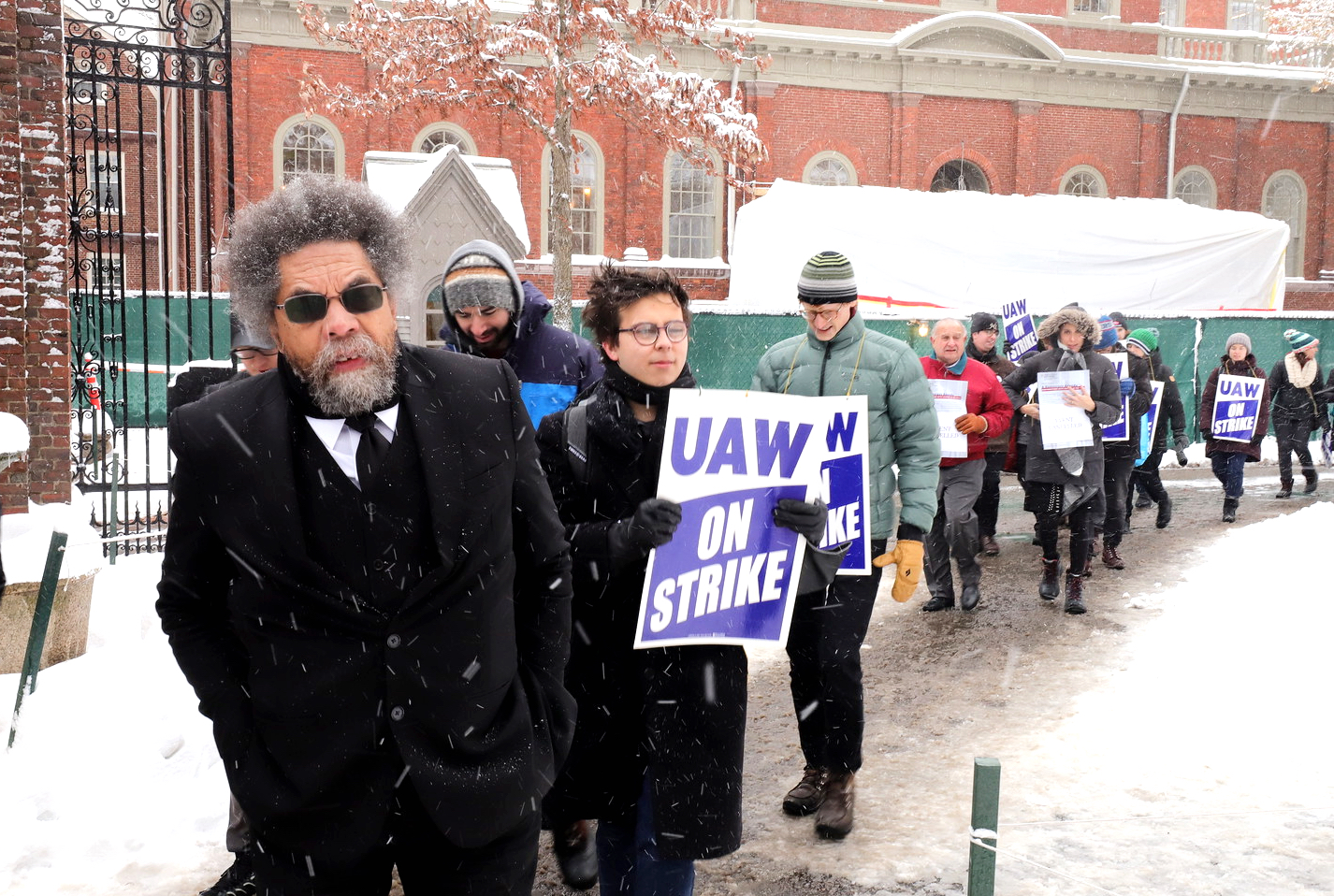 Practice of Public Philosophy Cornel R. West '74 joined members of the Harvard Graduate Students Union - United Automobile Workers on the picket lines during their strike in 2019. West threatened to leave Harvard for a second time this week after he said the University dismissed his request to be considered for tenure.