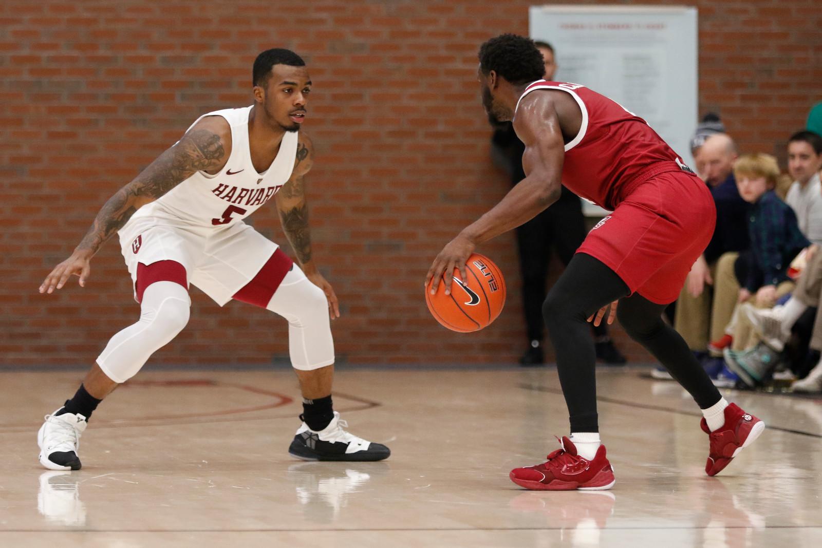 Rio Haskett exhibits his lockdown defense against Massachusetts in a dominant Crimson performance.