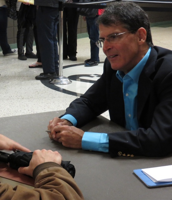 Dr. Eben Alexander is chatting at a conference.