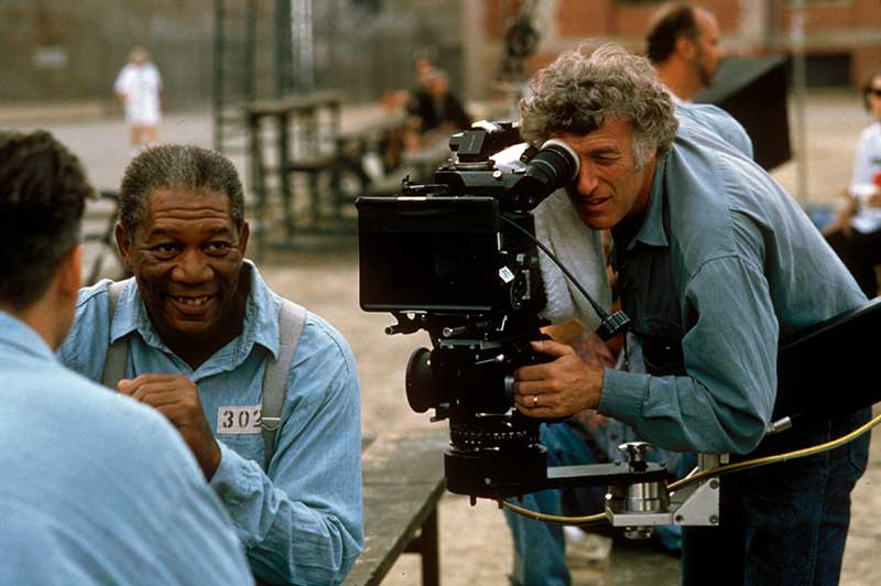 Cinematographer Roger Deakins films Morgan Freeman, who stars as Red Redding and Tim Robbins, who stars as Andy Dufresne.