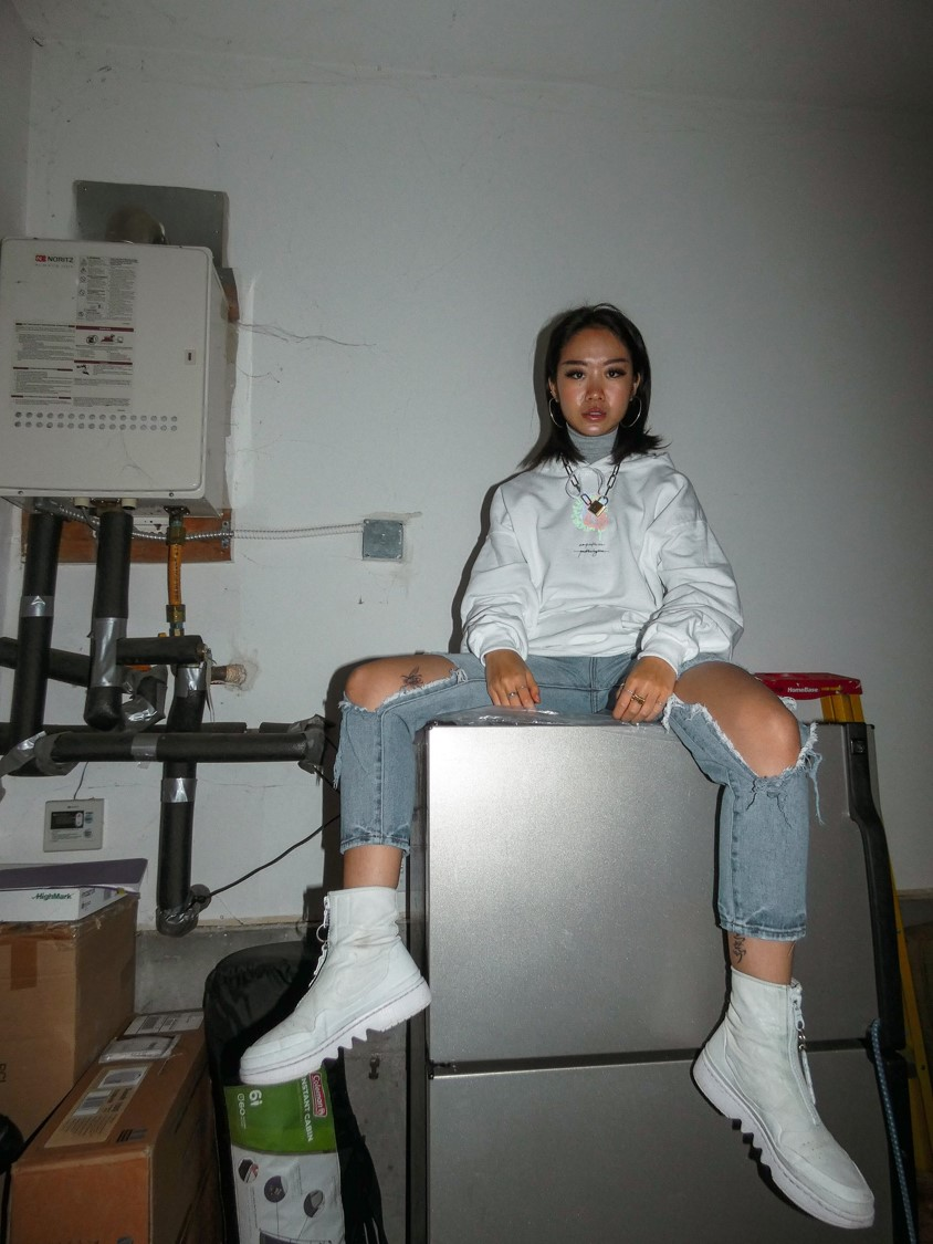 Kelsey Chen models a new hoodie released by Bodhi Parts.