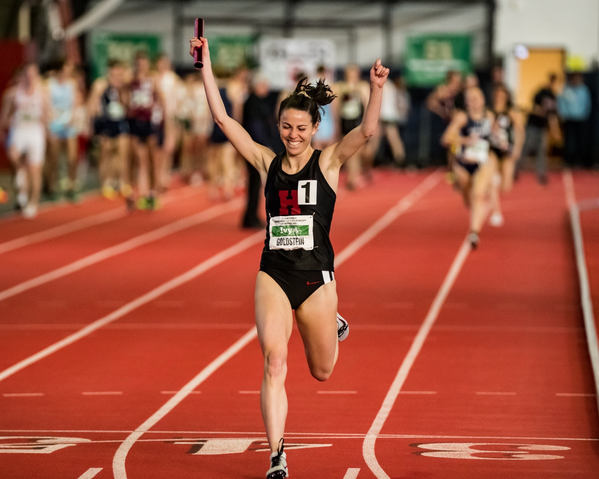 Junior distance runner Abbe Goldstein crosses the relay finish line with a comfortable margin, showing the speed that helped her qualify for NCAA Indoor Track and Field Championships.