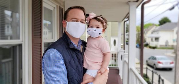 Lambert's husband Matt and young daughter Aliana pose in their Esmeralda masks.