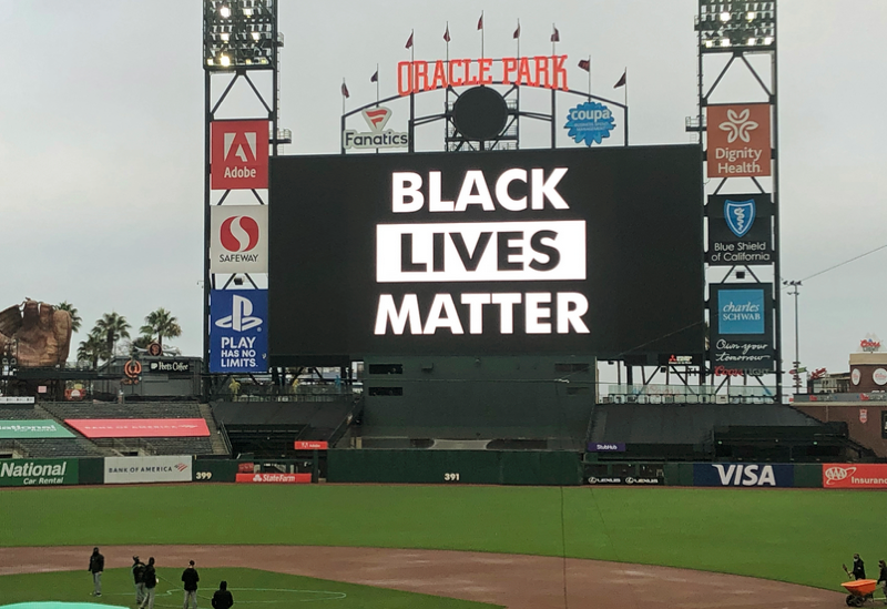 The scoreboard at Oracle Park in San Francisco, where Wednesday's game between the Los Angeles Dodgers and San Francisco Giants was one of three MLB games to be postponed after player conversations.