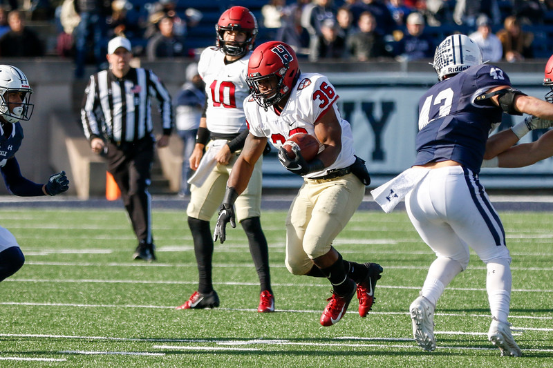 Senior running back Devin Darrington, pictured above in his final game in a Harvard uniform, announced his transfer to the University of Virginia.