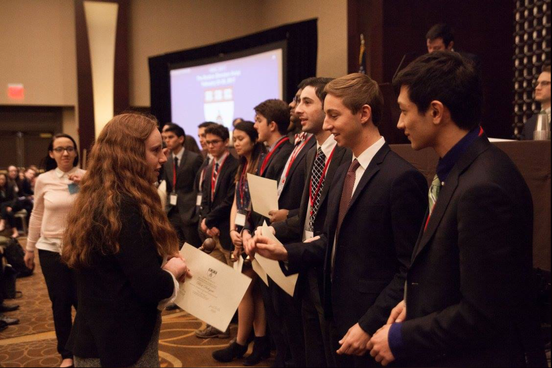 Members of Harvard Model Congress lead an awards ceremony.