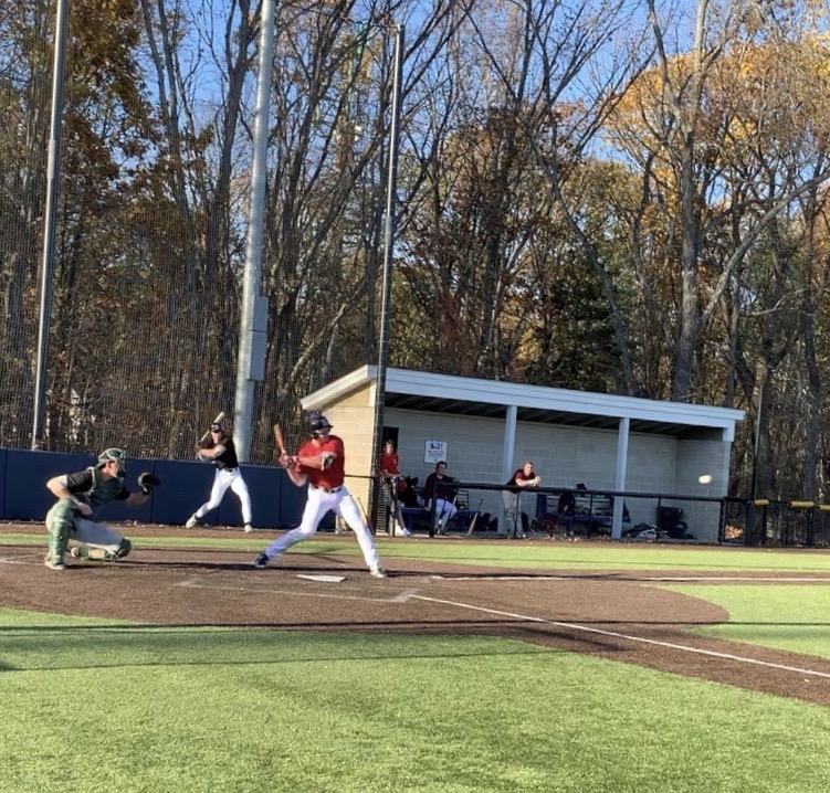 Tommy Seidl '21 hits during a weekly scrimmage at the New England Baseball Complex in Northborough, Mass. Scrimmages have been taking place at the site throughout fall 2020.