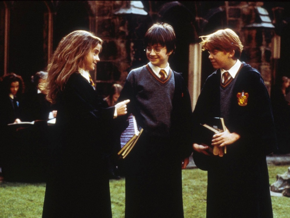 """Emma Watson as Hermione, Daniel Radcliffe as Harry, and Rupert Grint as Ron in the """"Harry Potter"""" franchise."""