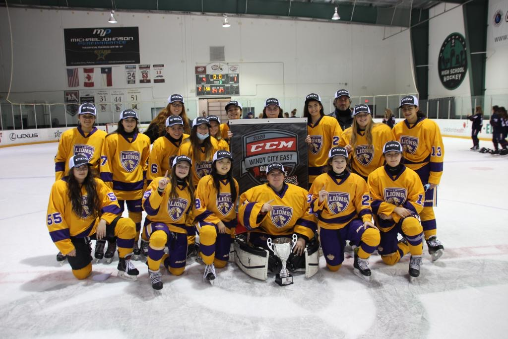 Dom Petrie (back left), junior forward on the Harvard women's hockey team and LA Lions coach, poses with the Lions after a 4-1 tournament final victory. The win would cap an undefeated run through the 2020 CCM Dallas Tournament.