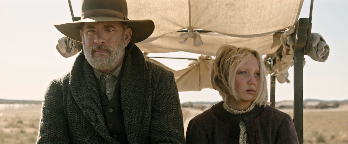 """Tom Hanks (left) stars as Captain Jefferson Kyle Kidd and Helena Zengel (right) stars as Johanna Leonberger in """"News of the World"""" (2020), directed by Paul Greengrass."""