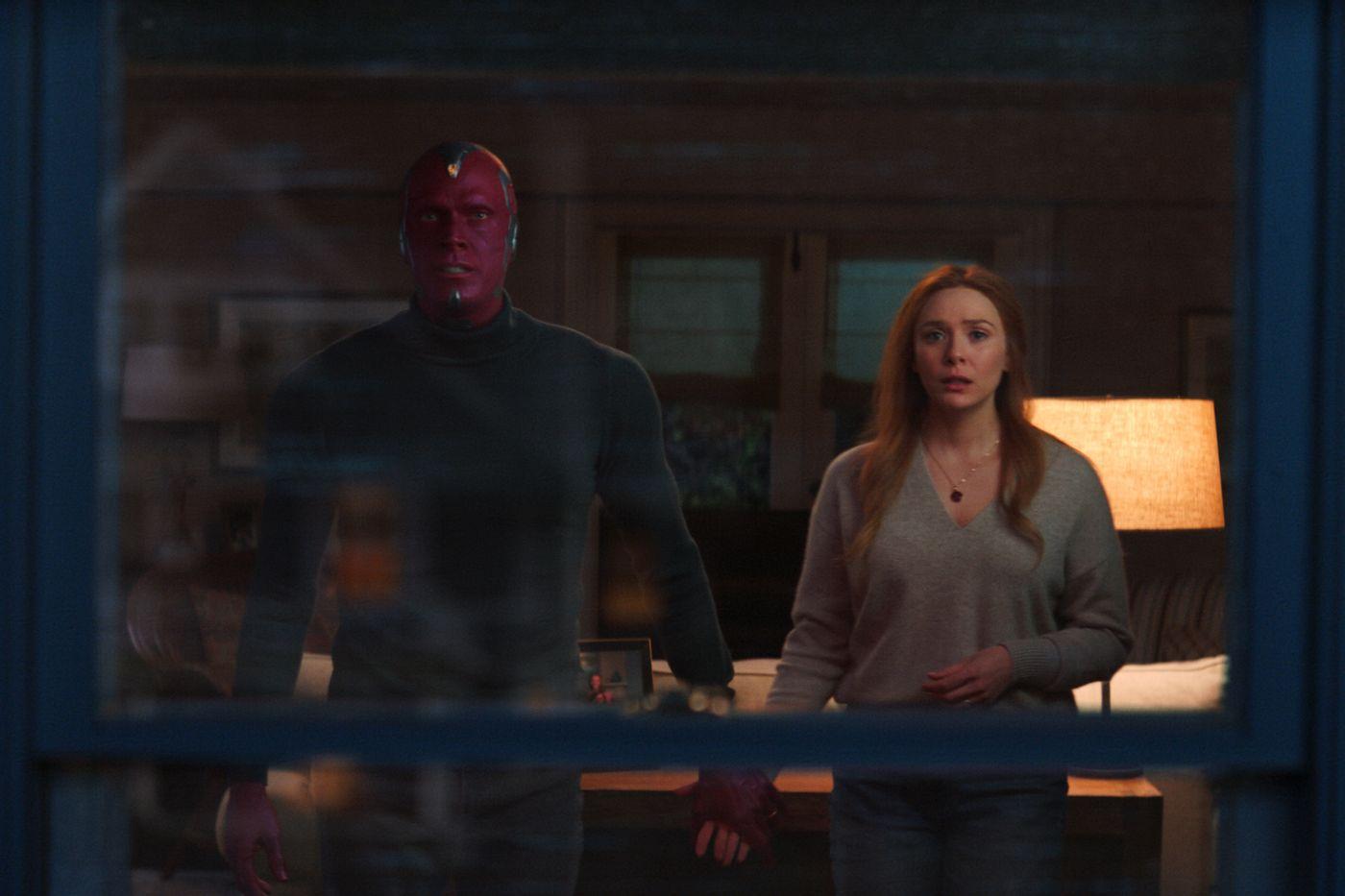 "Paul Bettany as Vision and Elizabeth Olsen as Wanda in ""WandaVision."""