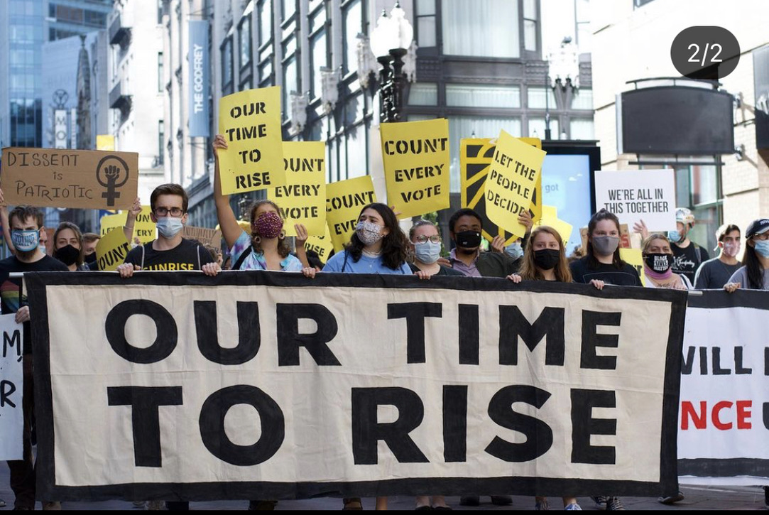 Young people march for climate action at a Sunrise Movement protest. Sunrise is a national organization working to stop climate change and create green jobs.