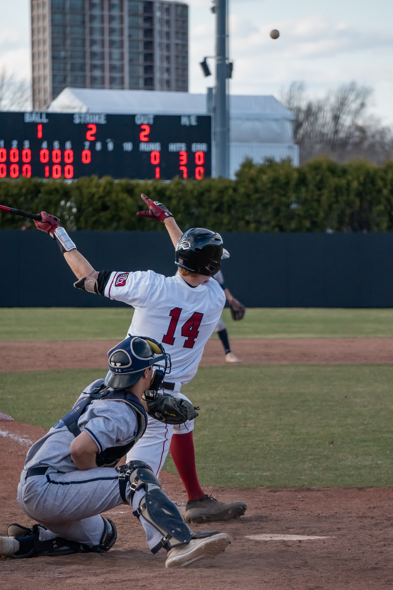 Matt Thomas '21 launches a drive into left field against rival Yale in an April 2019 meeting.