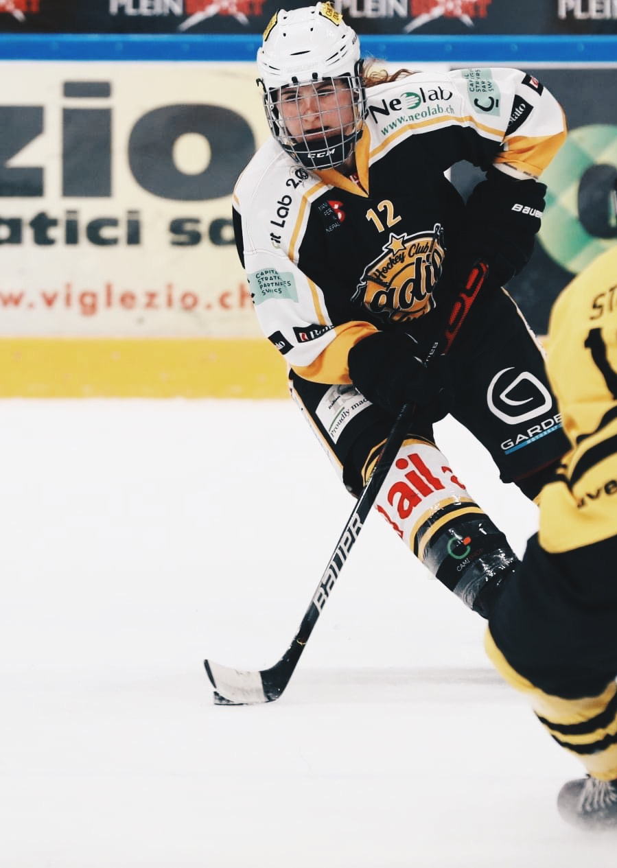 Forward Keely Moy (#12, pictured above) averaged 1-point per game in the 2020-21 campaign for HC Ladies Lugano, a season that ended with Lugano winning the Swiss championship, three games to one, in a best-of-five series. Brother Tyler Moy, also a forward, has played in Switzerland since the 2018-19 season.