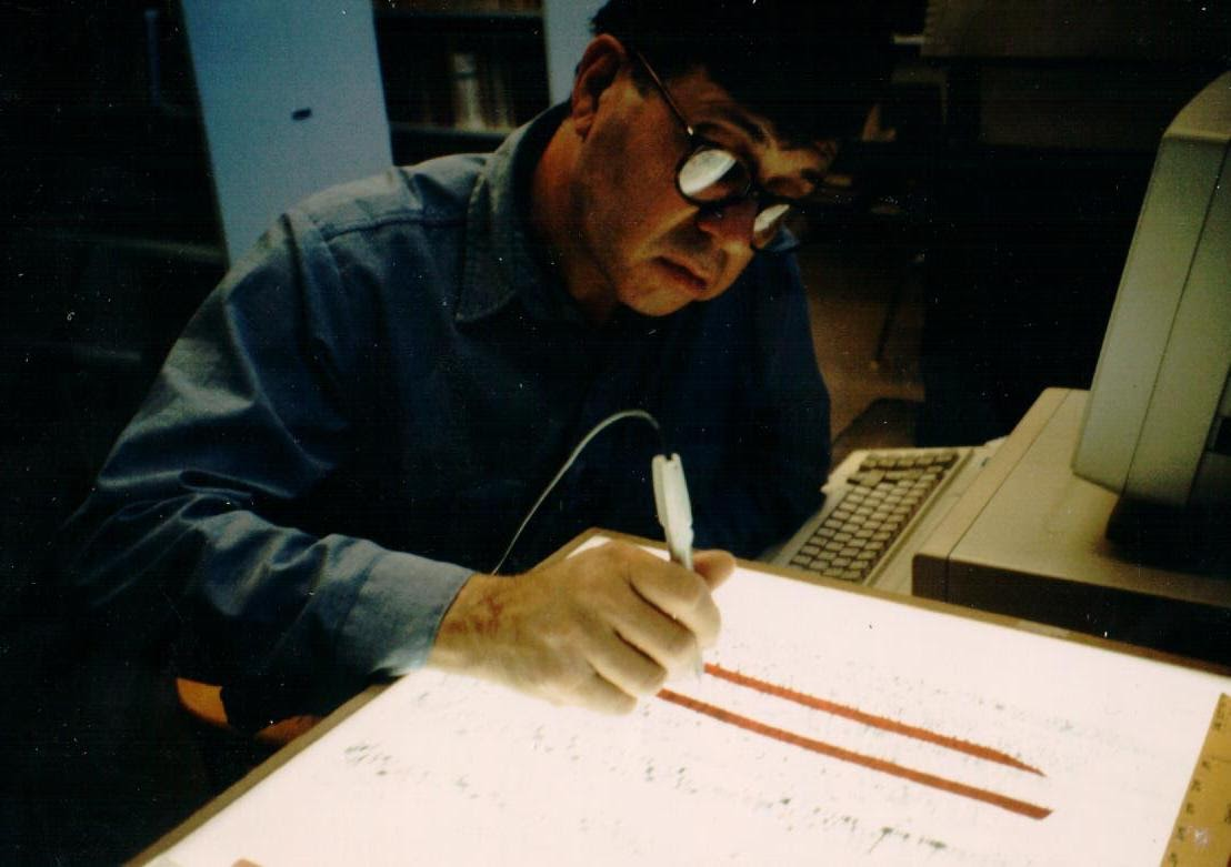 Richard C. Lewontin '50 — a prolific scientist who developed new methods for analyzing genetic variance — in the lab, manually scoring a DNA sequence.