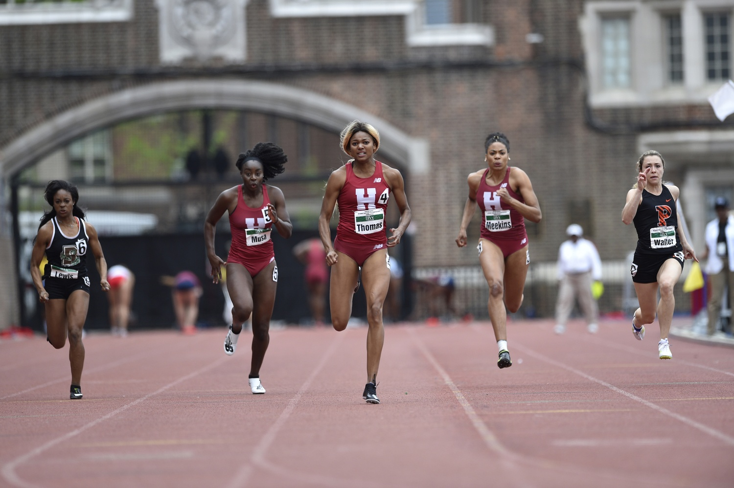 With a two-medal performance in Tokyo, Gabby Thomas '19, pictured above during her Harvard tenure, headlines the class of 15 current and former Crimson student-athletes competing at the Games.