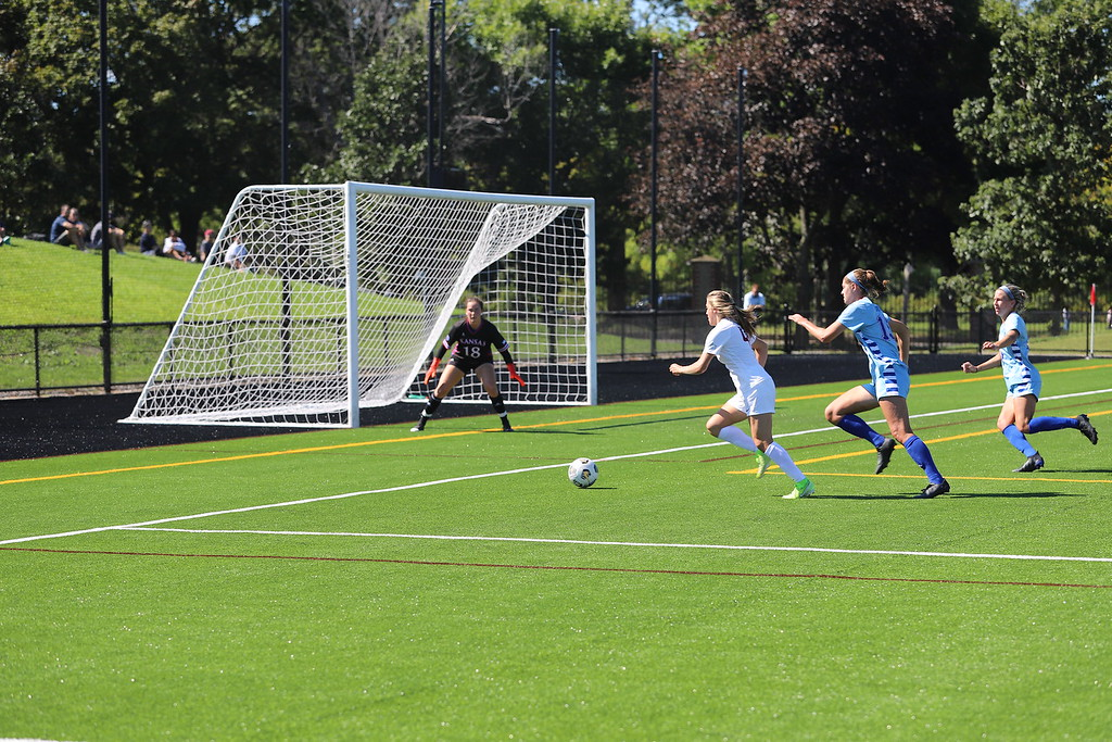 First-year Midfielder Hannah Bebar prepares to shoot in Harvard's win over Kansas on September 19. Against Yale on Saturday, Harvard took the lead early in the second half and did not look back.