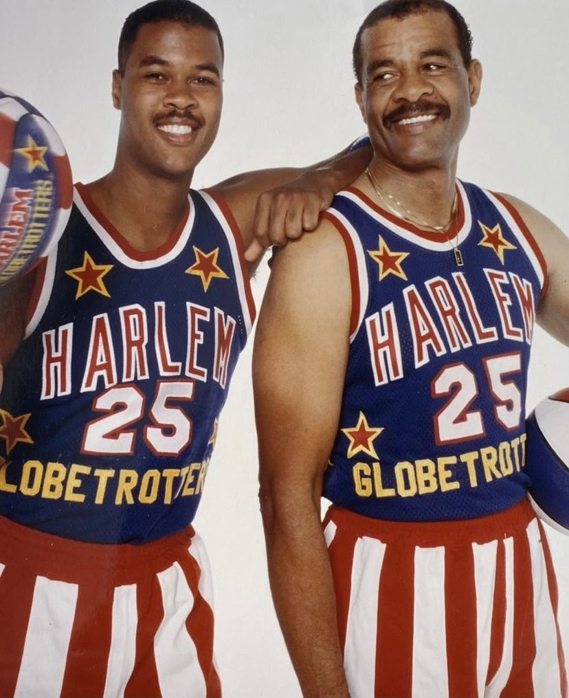 Sterling and Sterling Sr., Mason and McKenzie's father and grandfather, pose in their Globetrotter uniforms.