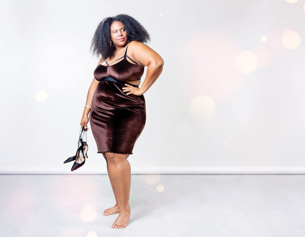 Plus size woman of color modeling Impish Lee