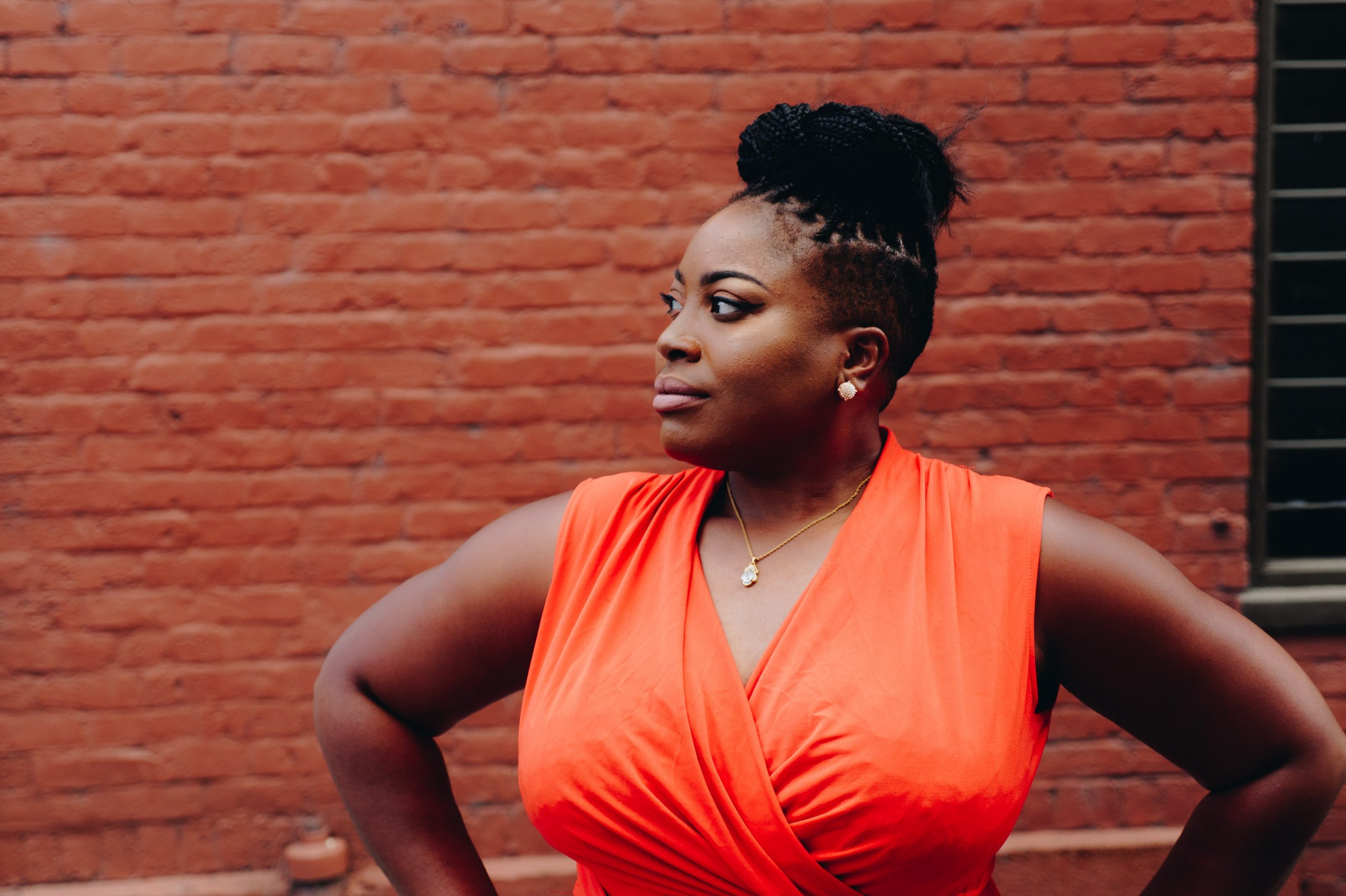 Plus SIze Black woman in orange dress