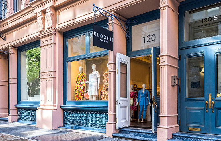 A picture of the Eloquii Soho Storefront location with mannequin in front