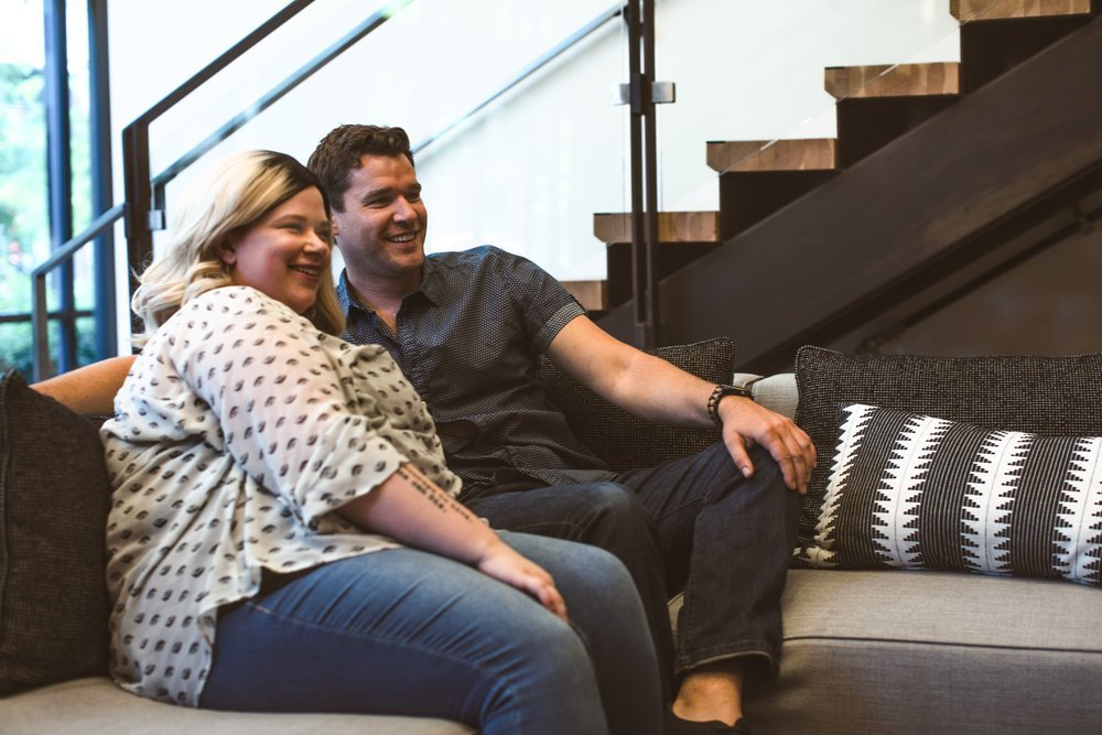 plus size couple on couch watching tv