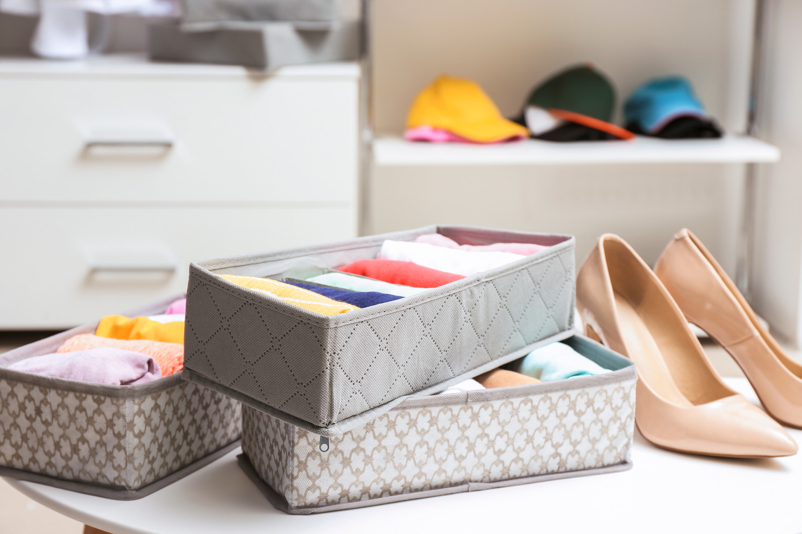 Organizers with clean clothes in closet Spring Clean your closet stock photo