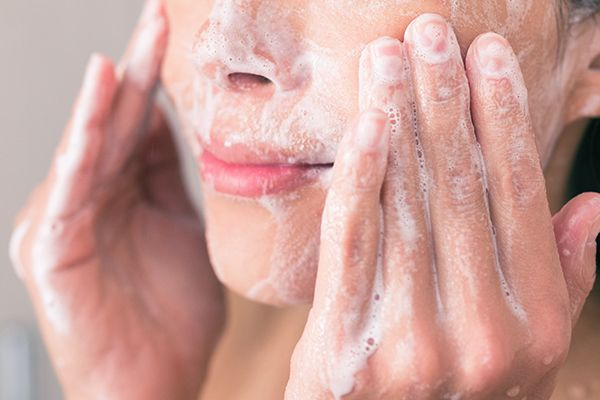 close-up-of-woman-cleansing-her-skin.-skin-care