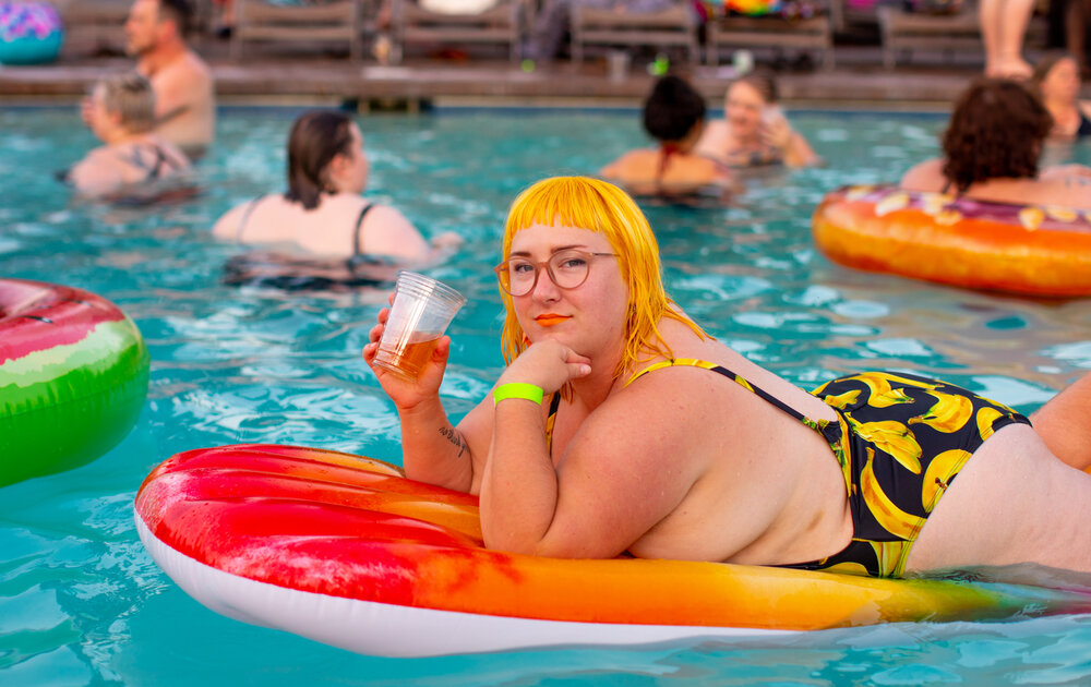 all go stock photo. plus size person in swimming pool- memorial day
