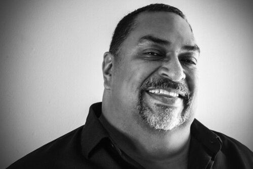 A black and white headshot of author Phillip Barragan.