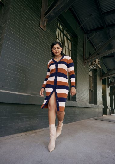Woman in ELOQUII Elements striped dress.
