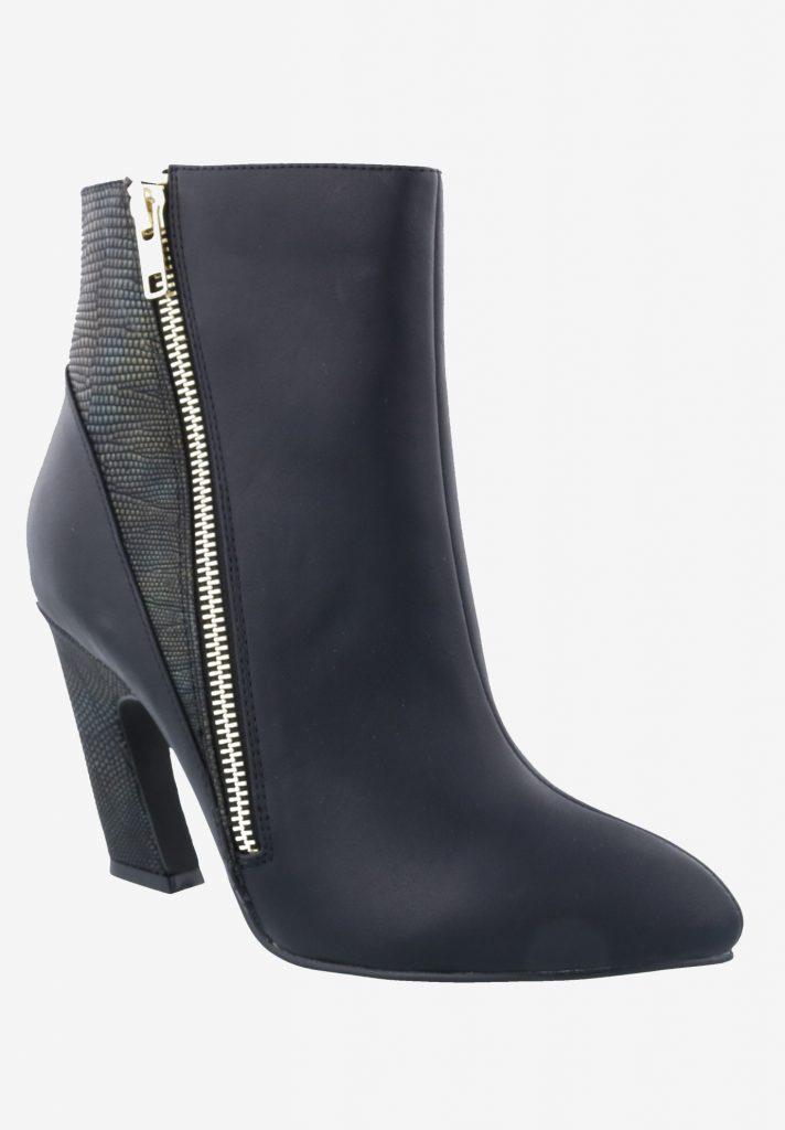 a dark blue boot with zipper