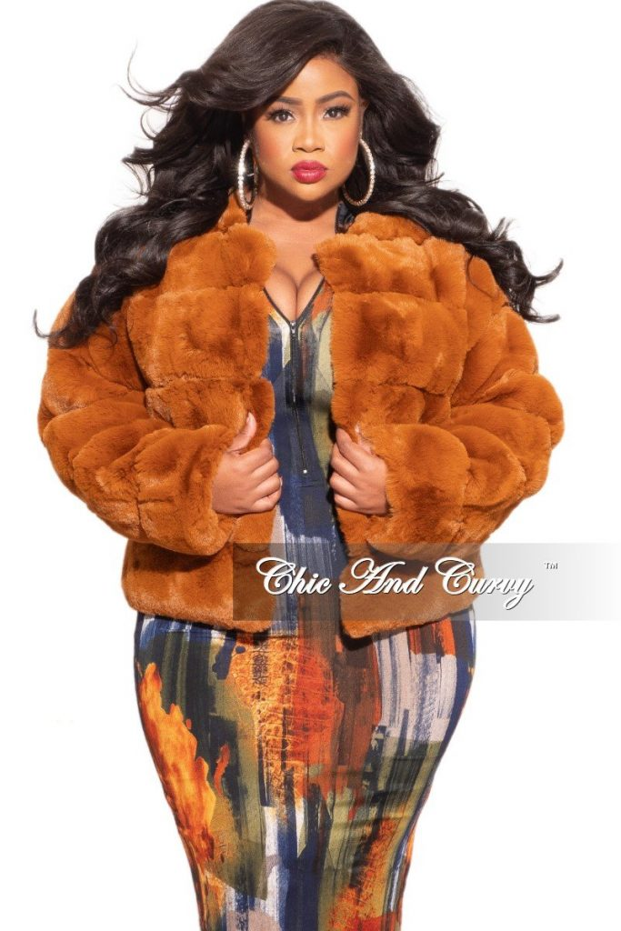 Woman wearing a Chic And Curvy Fur Rust Coat