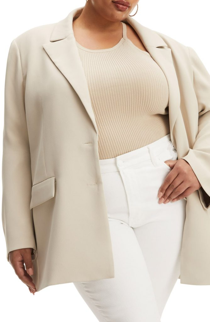 Woman wearing a cream colored oversized blazer