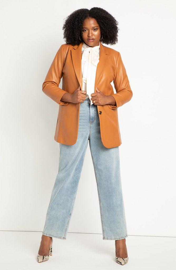 Woman wearing a dark orange colored faux leather blazer